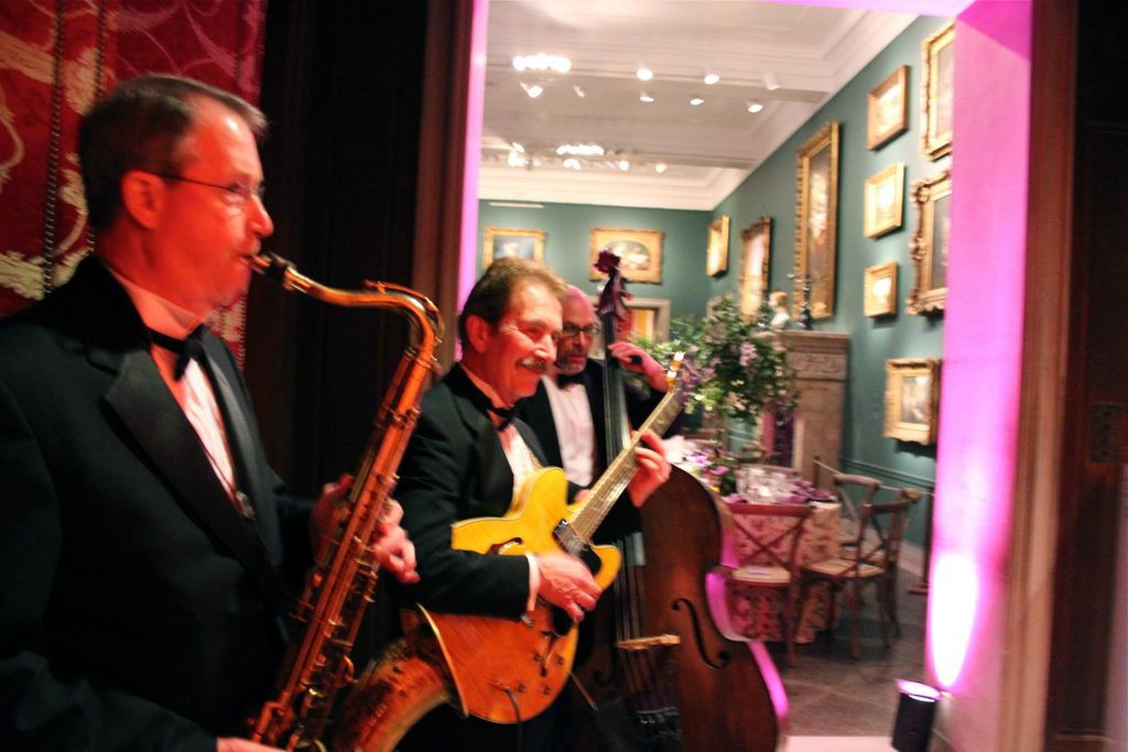 Autumn Trio playing jazz music as guests enter for dinner