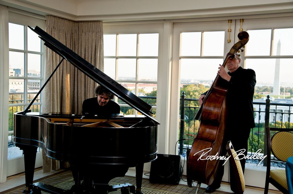 Piano & Bass Duo at the Top of the Hay