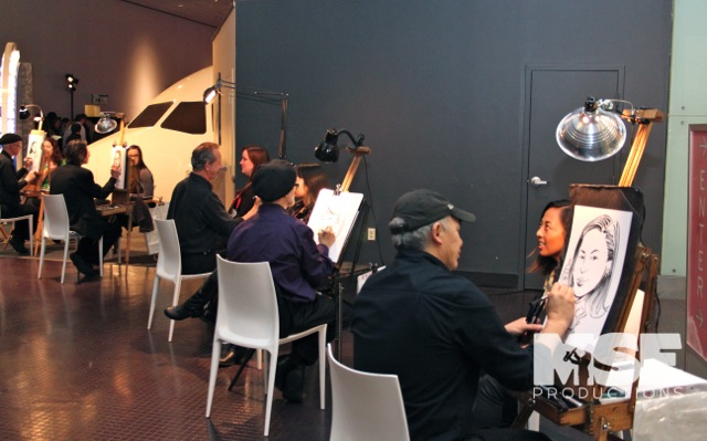 Caricaturists drawing guests at a corporate party