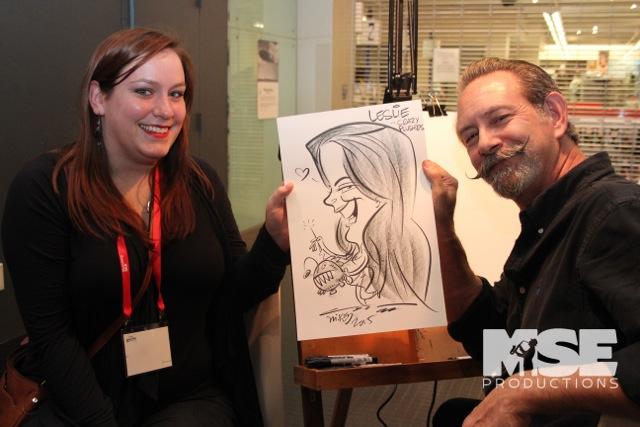 Caricaturist with another happy patron!