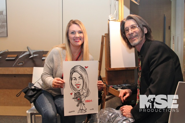 A cheerful guest after seeing her caricature!